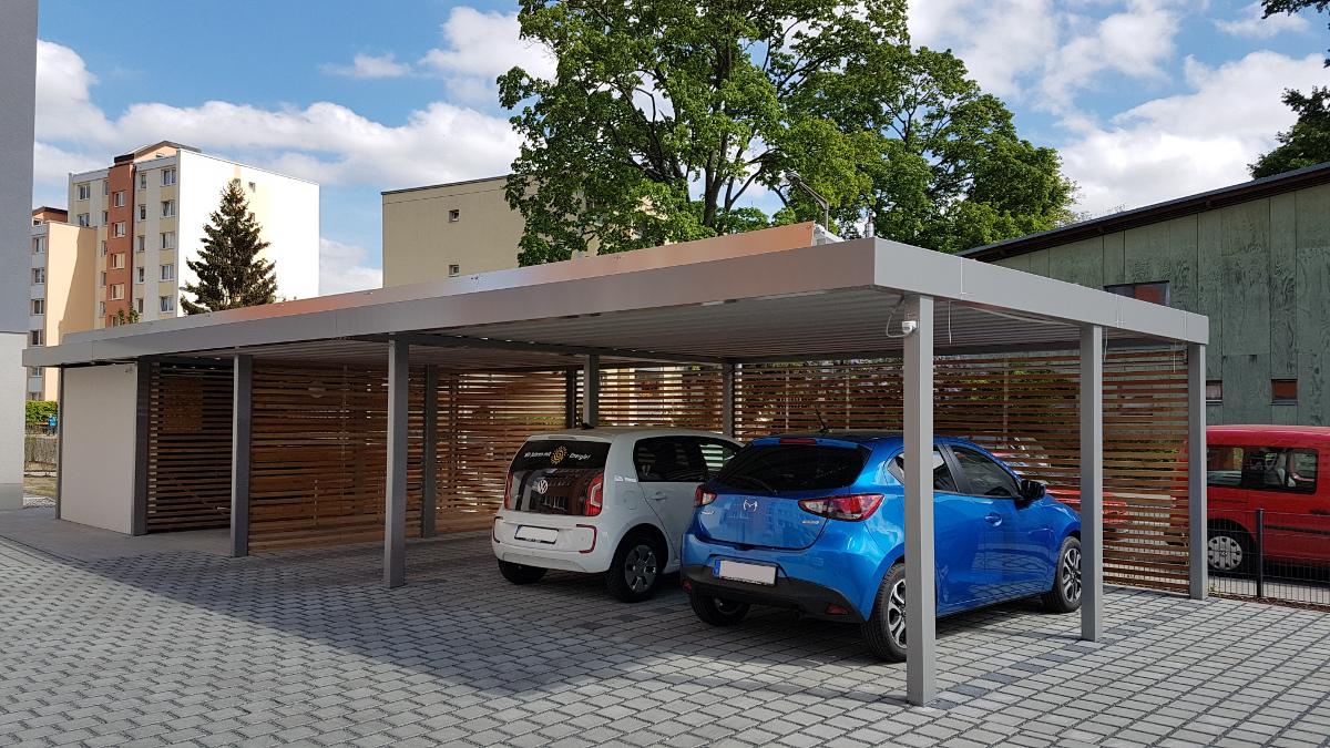 Carport-Reihenanlage mit Mülltonneneinhausung (Geräteraum) und Fahrradraum integriert - BRANDL