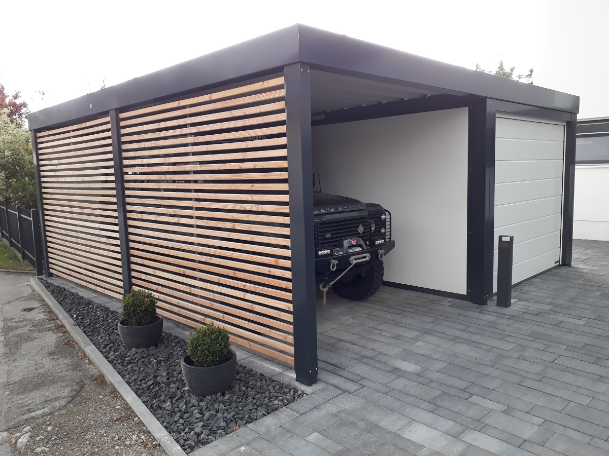 einzel carport aus stahl mit sektionaltor anbau carport. Black Bedroom Furniture Sets. Home Design Ideas